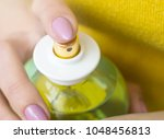 young woman applying perfume on ... | Shutterstock . vector #1048456813