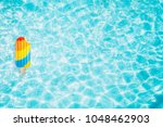 pool float  ring floating in a... | Shutterstock . vector #1048462903