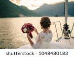 wedding bride travel on yacht.... | Shutterstock . vector #1048480183