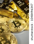 golden bitcoin coin and gold....   Shutterstock . vector #1048496347