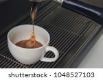 close up of espresso pouring to ... | Shutterstock . vector #1048527103