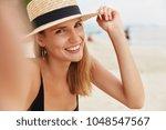 portrait of happy adorable... | Shutterstock . vector #1048547567