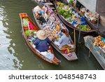 damnoen saduak floating market...   Shutterstock . vector #1048548743