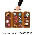 vintage old travel suitcase in... | Shutterstock .eps vector #1048557593
