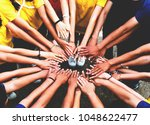 human hands unity with their... | Shutterstock . vector #1048622477