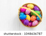 easter eggs in basket on wooden ... | Shutterstock . vector #1048636787