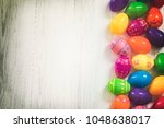 colorful easter eggs on wooden... | Shutterstock . vector #1048638017