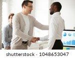 caucasian team leader or... | Shutterstock . vector #1048653047