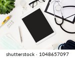 tablet computer with pen and... | Shutterstock . vector #1048657097