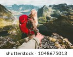 couple travelers follow holding ... | Shutterstock . vector #1048675013