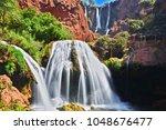 ouzoud falls near the grand...   Shutterstock . vector #1048676477