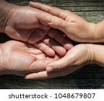 young woman holding the hand of ...   Shutterstock . vector #1048679807