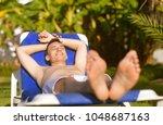 summer holidays. young man... | Shutterstock . vector #1048687163