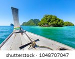longtail boat in sea during... | Shutterstock . vector #1048707047