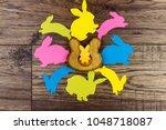 happy easter concept. wooden...   Shutterstock . vector #1048718087