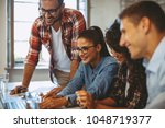 good news young team in the...   Shutterstock . vector #1048719377