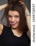 positive portrait of pretty... | Shutterstock . vector #1048728557