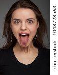 positive portrait of pretty... | Shutterstock . vector #1048728563