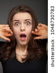shocked and surprised girl... | Shutterstock . vector #1048730783