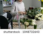 florist with bouquet of roses... | Shutterstock . vector #1048732643