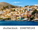 multi colored houses on the...   Shutterstock . vector #1048785143