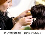 the hairdresser does a... | Shutterstock . vector #1048792337