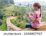 cute girl enjoying a view over... | Shutterstock . vector #1048807937