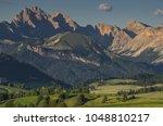 summer eve in alpe di siusi... | Shutterstock . vector #1048810217