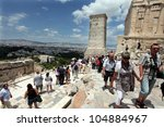 Small photo of ATHENS, GREECE - JUNE 26: Tourists in famous old city Acropolis Parthenon Temple on June 26, 2011 in Athens, Greece. Its construction began in 447 BC in the Athenian Empire. It was completed in 438 BC