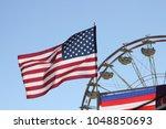 american flag at a fair  | Shutterstock . vector #1048850693