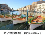 Small photo of Colorful traditional boats in Sete, a seaside resort and singular island in the Mediterranean sea, it is named the Venice of Languedoc Rousillon, France