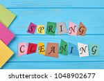 text spring cleaning on wooden... | Shutterstock . vector #1048902677