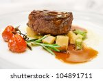 Tenderloin steak on restaurant table - stock photo