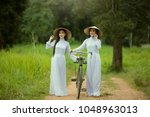 vietnamese people two women... | Shutterstock . vector #1048963013