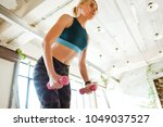 sporty girl with a beautiful... | Shutterstock . vector #1049037527