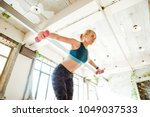 sporty girl with a beautiful... | Shutterstock . vector #1049037533