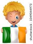 boy holding ireland flag... | Shutterstock .eps vector #1049044973