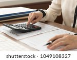 Small photo of Business women reviewing data in financial statement. Accounting , Accountancy, Bookkeeping Concept.