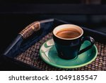 hot espresso coffee in black... | Shutterstock . vector #1049185547