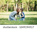 happy mother and daughter with... | Shutterstock . vector #1049194517