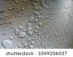 water drop on a steel...   Shutterstock . vector #1049206037