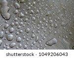 water drop on a steel...   Shutterstock . vector #1049206043