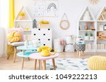 yellow phone on pink  round... | Shutterstock . vector #1049222213