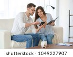 young couple thinking over... | Shutterstock . vector #1049227907