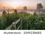 landscape view across field to... | Shutterstock . vector #1049238683