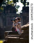 asian woman taking a photograph ... | Shutterstock . vector #1049240273