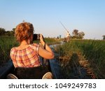 adventurous tourist relaxing... | Shutterstock . vector #1049249783