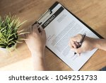 businessman signing on contract ... | Shutterstock . vector #1049251733