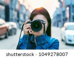 photographer taking pictures... | Shutterstock . vector #1049278007