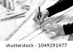 dressmaker designer making... | Shutterstock . vector #1049291477